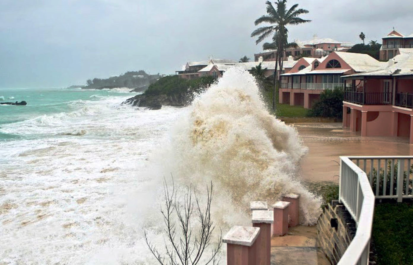 Large waves crashing against buildings