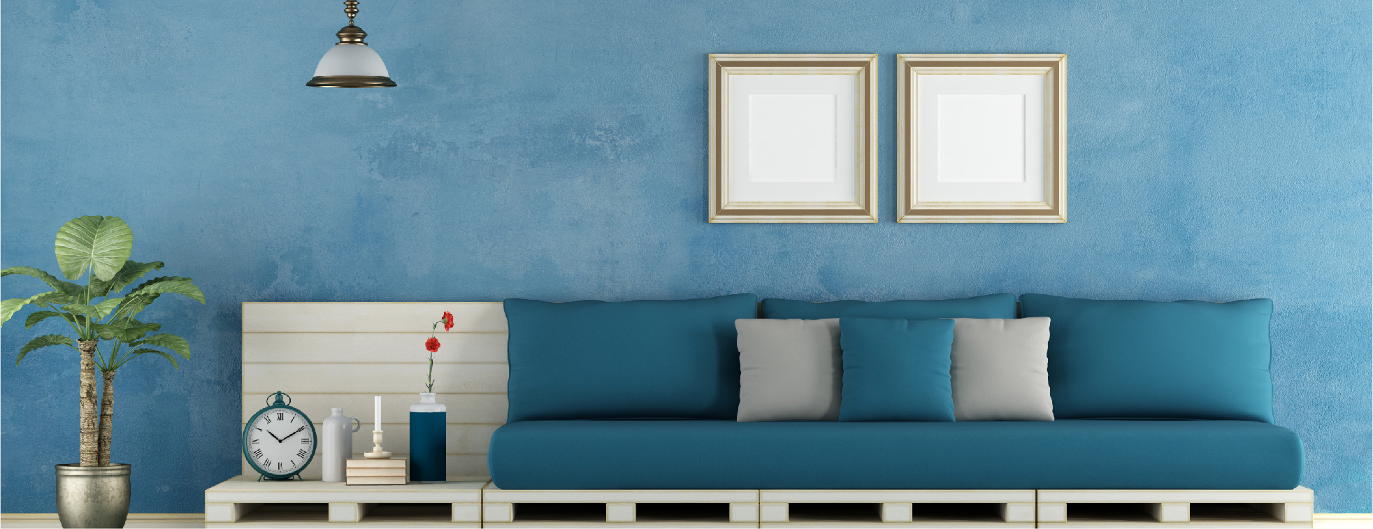 A blue plaster walll with blue and gray furniture